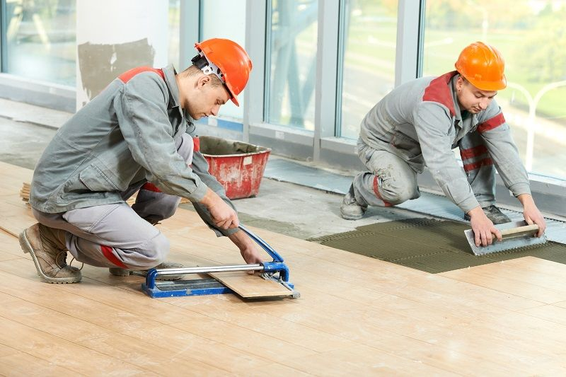 ABI Pic Two tilers at industrial floor tiling renovation 5.25.17 Large cm 1