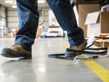 An industrial safety topic. A worker tripping over a trash on a factory floor cm 440x293 350x263