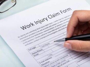 Woman Filling Work Injury Claim Form cm 440x293 350x263